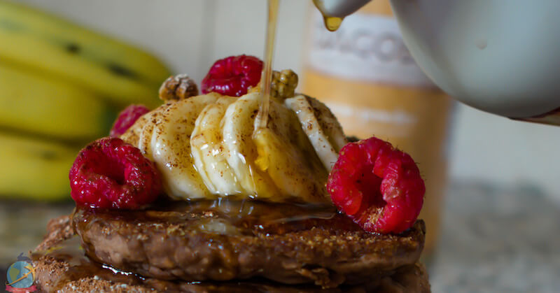 Banana cacao pancakes with rasperry and banana on top