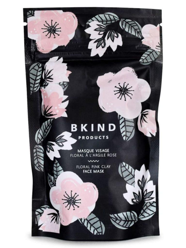 mascarilla facial vegana de la marca bkind el empaque es negro con flores rosa pastel