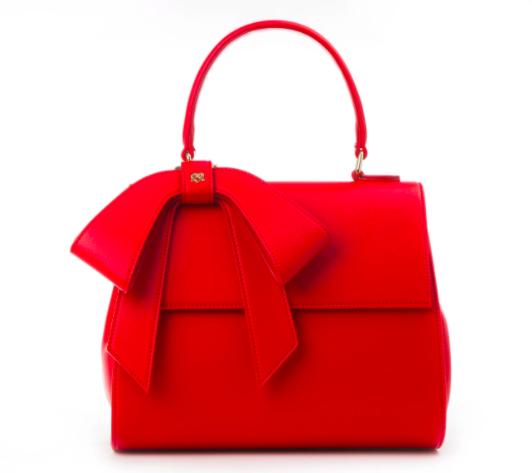 Bolso vegano marca gunas en color rojo con un lazo decorativo regalos veganos